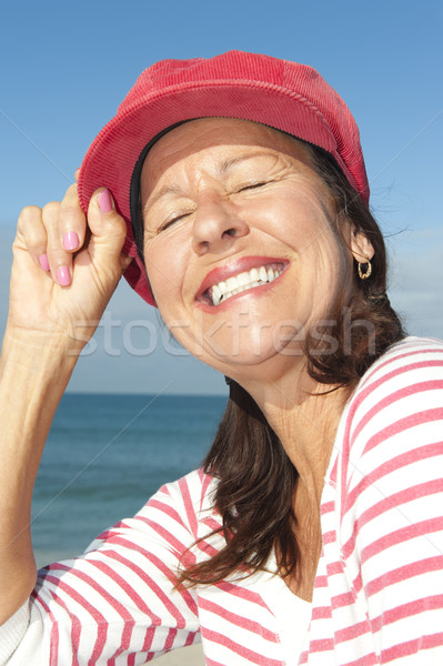 Cheerful mature woman ocean background Stock photo © roboriginal