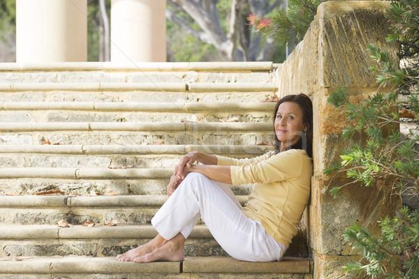 Starsza kobieta zewnątrz portret piękna posiedzenia Zdjęcia stock © roboriginal