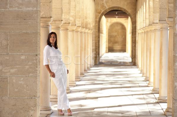 Confident sexy mature woman standing archway Stock photo © roboriginal