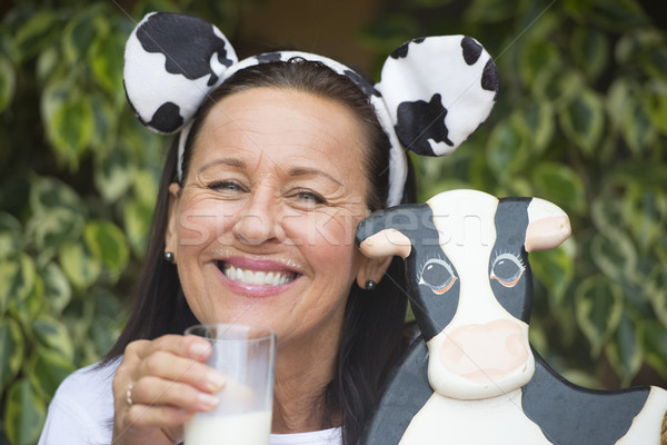 Funny mature woman with milksop and cow Stock photo © roboriginal