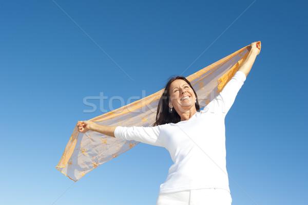 Joyful mature woman sky isolated Stock photo © roboriginal