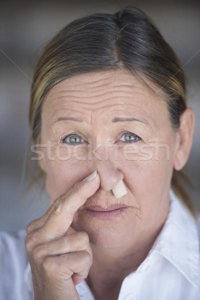 Mulher nariz plugue retrato infeliz Foto stock © roboriginal