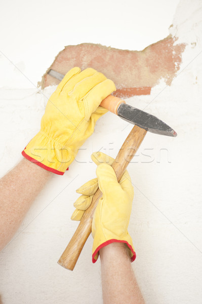 Stock photo: Interior House wall renovation hammer and bite