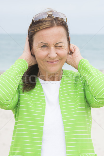 Friendly woman with twinkle face expression Stock photo © roboriginal