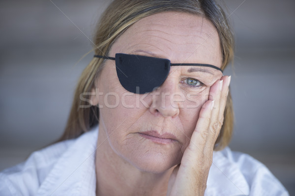 Tired woman with eye patch portrait Stock photo © roboriginal