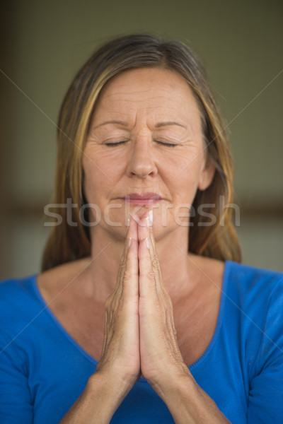 Happy Woman praying with closed eyes  Stock photo © roboriginal