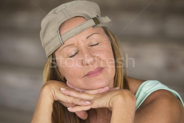 Portrait active fit mature woman closed eyes Stock photo © roboriginal