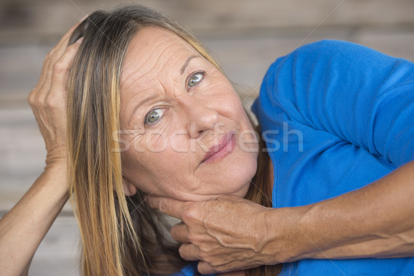 Laid back woman resting head on hand Stock photo © roboriginal