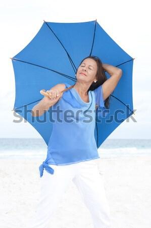 Portret verwonderd rijpe vrouw Blauw blouse mooie Stockfoto © roboriginal