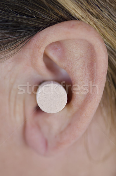 Close up ear with protective plug. Stock photo © roboriginal