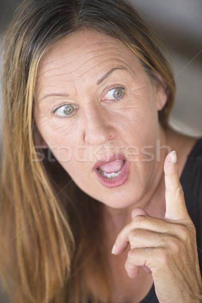 Surprised woman with idea finger pointing Stock photo © roboriginal