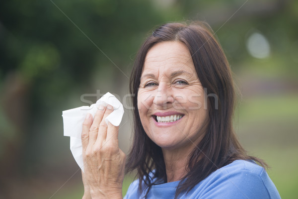 Smiling Woman with tissue outdoor Stock photo © roboriginal