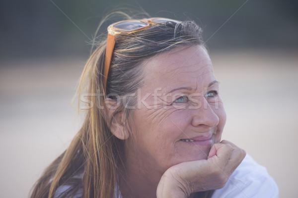 Confident mature woman smiling outdoor Stock photo © roboriginal