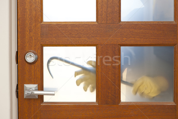 Thief with crowbar at house door break-in Stock photo © roboriginal