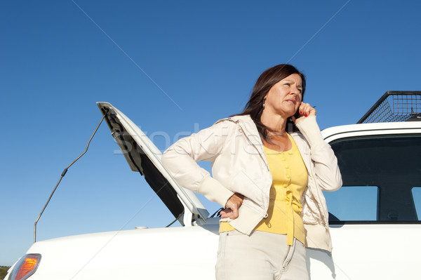 Woman calling road assistance Stock photo © roboriginal