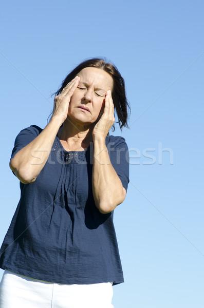 Starsza kobieta głowy niebieski portret smutne Zdjęcia stock © roboriginal