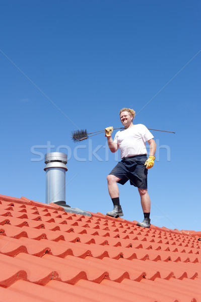 Man cleaning chimney on tiled roof Stock photo © roboriginal