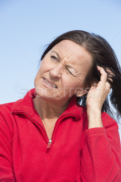 Worried concerned mature woman Stock photo © roboriginal