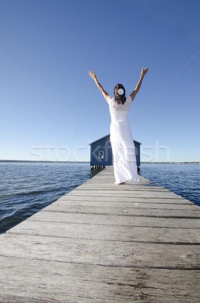 Joyful woman white dress on boardwalk at ocean Stock photo © roboriginal