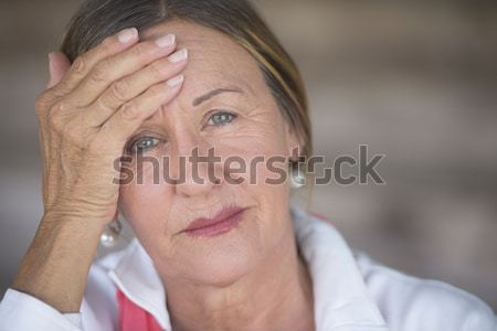 Woman with migraine headache portrait Stock photo © roboriginal