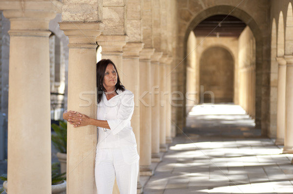 Attractive romantic mature woman archway pillar Stock photo © roboriginal
