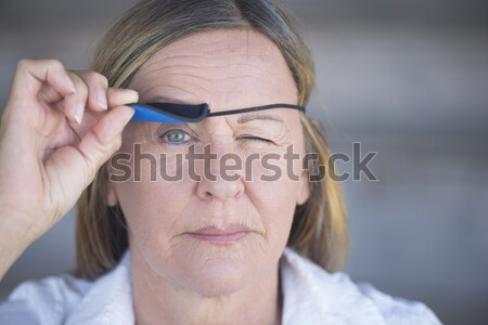 Stock photo: Relaxed woman lifting eye patch portrait