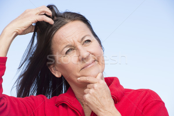 Stressed worried woman scratching head Stock photo © roboriginal