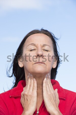 Worried mature woman wrinkled forehead Stock photo © roboriginal