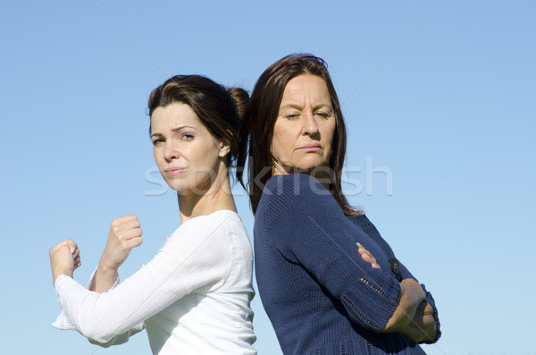 Strong and stubborn women back to back Stock photo © roboriginal
