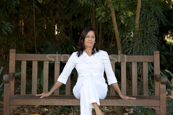 肖像 孤独 魅力的な 成熟した女性 屋外 座って ストックフォト © roboriginal