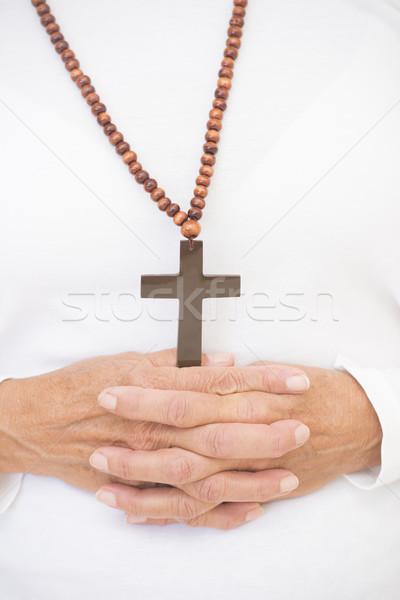 Praying hands and christian crucifix . Stock photo © roboriginal