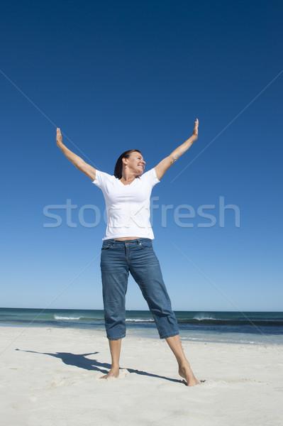 Fit and healty senior woman at beach Stock photo © roboriginal