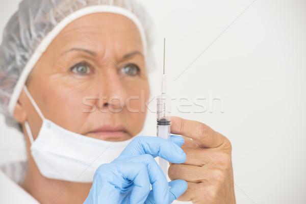 Női nővér injekció oltás portré komoly Stock fotó © roboriginal