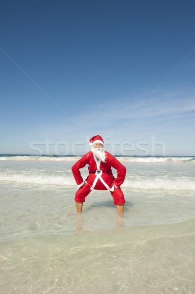 Happy Santa Clause at Ocean Holiday Stock photo © roboriginal