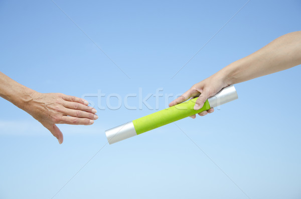 Isolated athletes hands with baton Stock photo © roboriginal