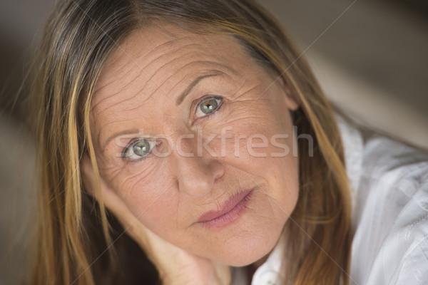 Confident attractive elegant mature woman Stock photo © roboriginal
