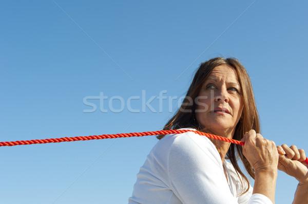 Stock fotó: Nő · húz · kötél · égbolt · érett · nő · néz
