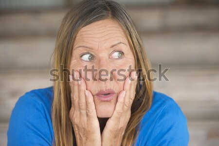 Shocked fearful woman portrait Stock photo © roboriginal