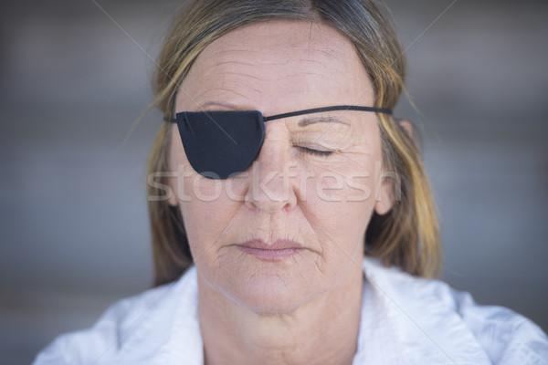 Mature woman with eye patch portrait Stock photo © roboriginal
