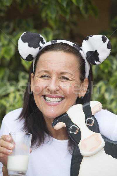 Happy mature woman with milksop and cow Stock photo © roboriginal