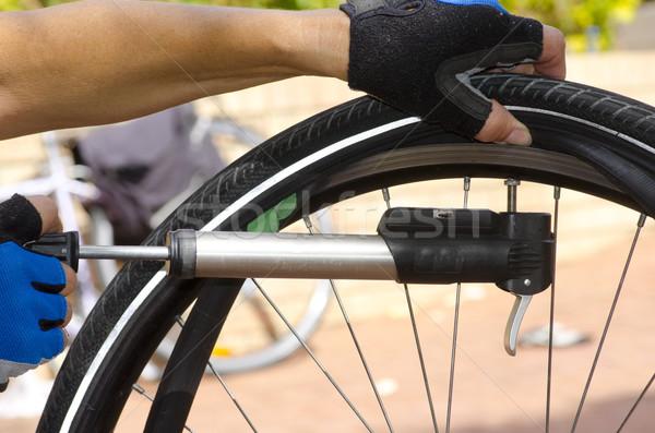 Pumping up repaired bike tyre Stock photo © roboriginal