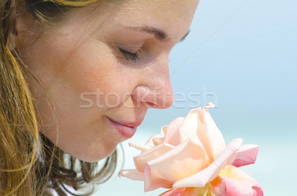 Joli jeune fille parfum fleur portrait Photo stock © roboriginal