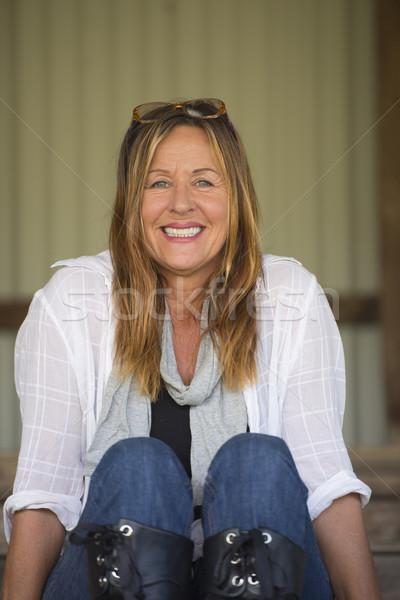 Happy relaxed confident mature woman Stock photo © roboriginal