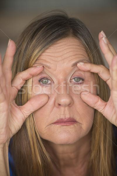 Tired stressed woman suffering headache Stock photo © roboriginal