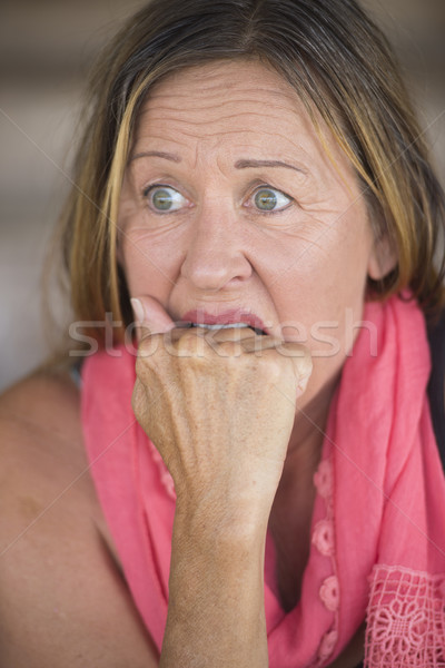 Stressed worried woman nail biting Stock photo © roboriginal