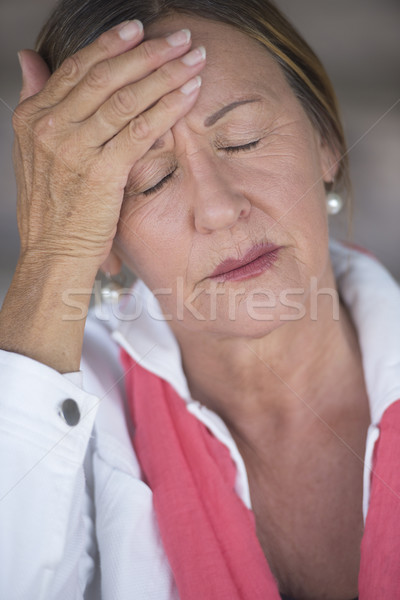 Woman with migraine headache closed eyes Stock photo © roboriginal