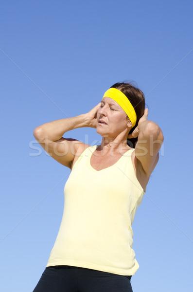 Senior woman exercising isolated outdoor Stock photo © roboriginal