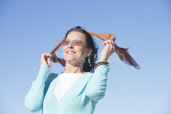 Aantrekkelijk rijpe vrouw outdoor mooie naar Stockfoto © roboriginal