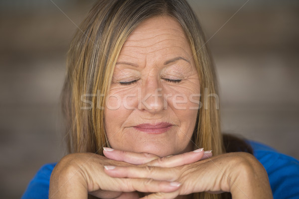 Peaceful relaxed woman closed eyes Stock photo © roboriginal