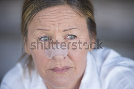 Thoughtful lonely mature woman portrait Stock photo © roboriginal